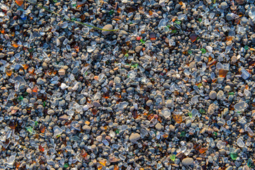 sea stones background with bits of glass