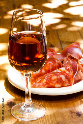 Fotobehang Picknick Glass of sherry with a snack (ham, jamon, parma).
