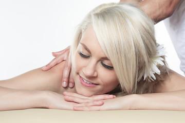 Woman having therapy massage of back in the spa salon. Beauty tr