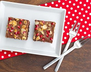 chocolate cake decorated with pomegranate and almond