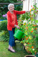 Old Woman at the Garden with Watering Can.