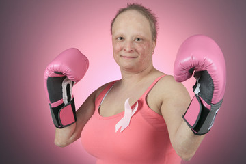 A Woman with boxing gloves ready to fight.