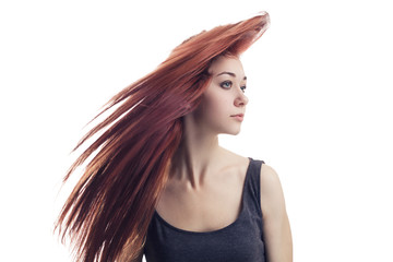 girl with flying hair isolated over white background