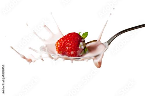 canvas print picture fresh strawberry splashing into the spoon full of yoghurt