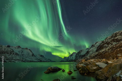 Aurora Borealis reflected between two fjords in Tromsø Photo by jamenpercy