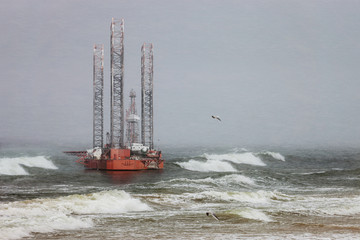 Oil rig in a winter storm day during a violent blizzard.