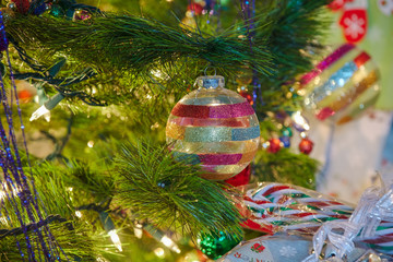 Colorful and Cheery Christmas decorations and gifts under a tree