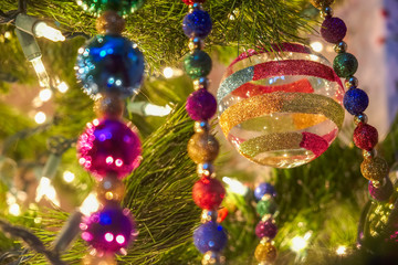 Colorful decorations adorn a Christmas Tree during the Holidays