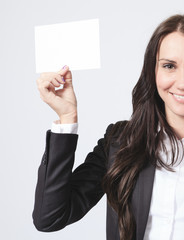 A business woman holding a white card.