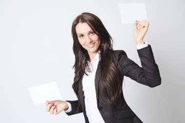 A business woman holding two white card.