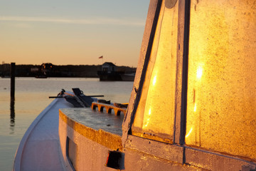 Lobster boat covered in frost at sunrise