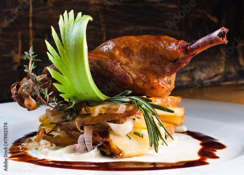 Fotobehang Kruidenierswinkel Duck pestle with potato. confit.