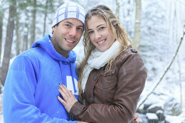 A couple having fun in the park, in winter holidays