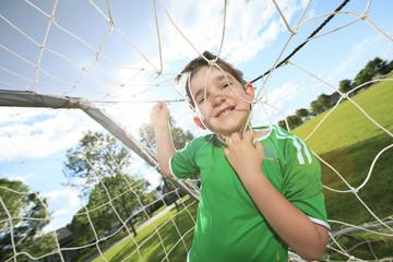 Kid play soccer on a field