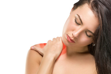 Brunette woman massaging her shoulder