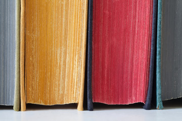 Old books with colored pages. Close-up. Soft focus.