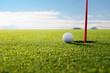 Leinwandbild Motiv golf ball and hole