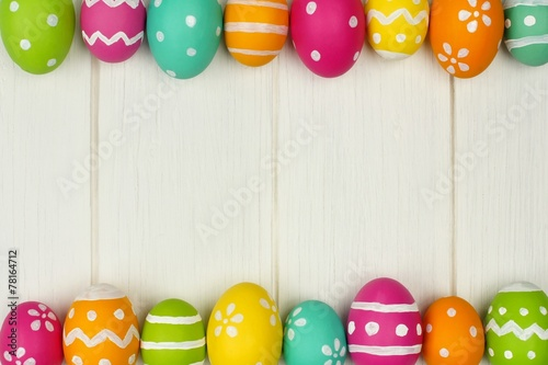 canvas print picture Colorful Easter egg frame against white wood