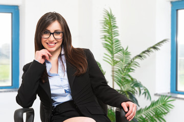 Smiling businesswoman sitting on a chair