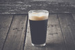 Pint of Dark Beer on Wood Background with Vintage Film Style - 78166707