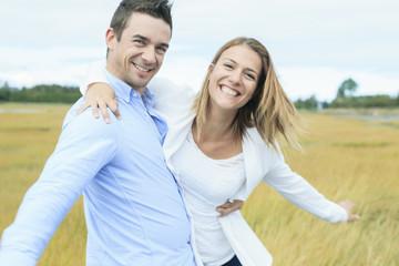 Young happy couple on summer season