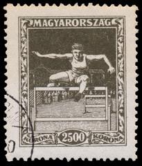 Stamp printed in Hungary shows hurdler