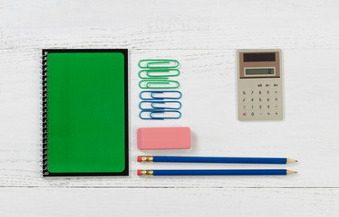 Organized supplies for work or school on white desktop