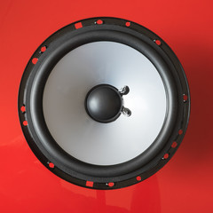 Speaker unit on red background