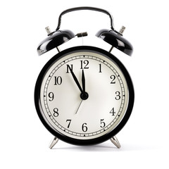 Black alarm clock isolated on white with shadow