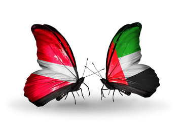 Two butterflies with flags Latvia and United Arab Emirates