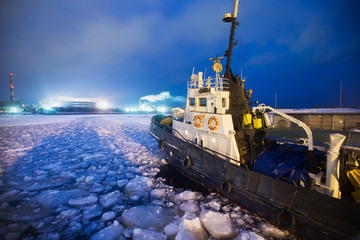 The Icebreaker ship trapped in ice tries to break and leave the