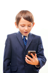 Business child in suit and tie posing with cell phone