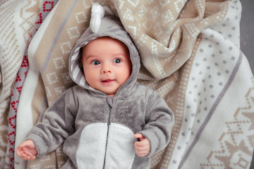 Adorable little baby in a funny bodysuit