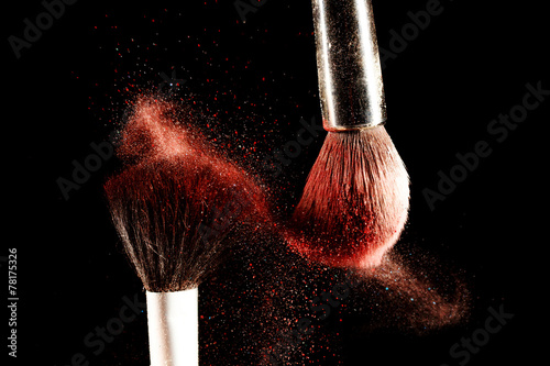 Brush and a powder spread out - 78175326