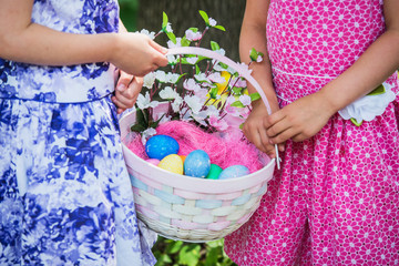 Two Girls Hands Holding an Easter Basket - Close Up