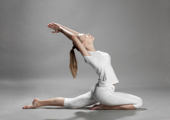young beautiful blonde woman doing yoga