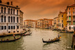 Sunset view of Grand Canal with gondolas in Venice. Italy