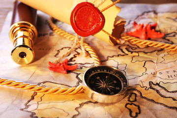 Marine still life with world map and spyglass