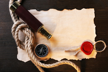 Marine still life spyglass, compass rope and sheet of paper
