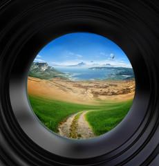 landscape seen through a door viewer