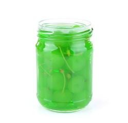 Homemade jar of green maraschino cherry isolated