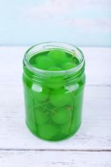 Homemade jar of green maraschino cherry