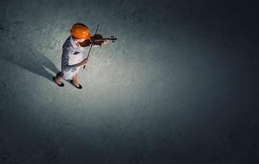 Engineer play violin