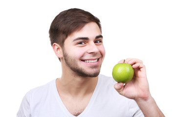Portrait of young man with green apple isolated on white