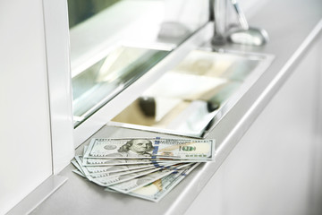 Money on surface near cash department window