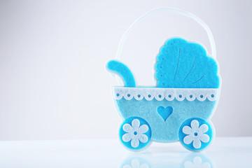 Blue little pram isolated on white