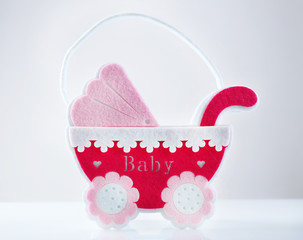 Pink little pram isolated on white