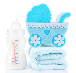 Blue little pram and bottle of milk isolated on white