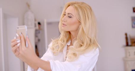 Gorgeous Blond Woman Taking Selfie Photo