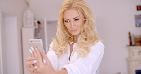 Gorgeous Blond Woman Taking Selfie Photo